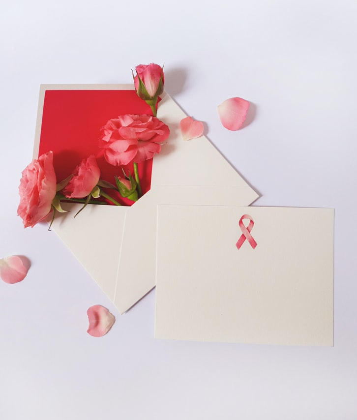 envelopes with roses and Breast Cancer Awareness ribbon